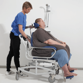 Bariatric rehab shower chair, attendant propelled