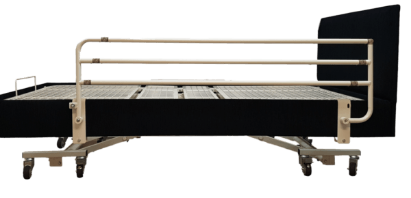 side rail for bed attached to base bed. Full length and adjustable
