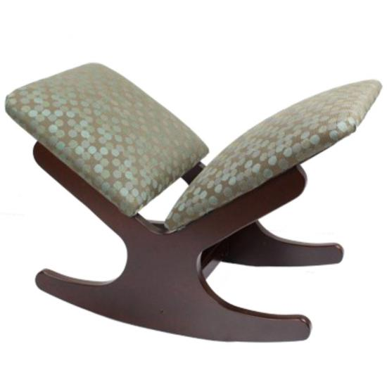 Oscar foot rest with a curved rocking style base to assist in finding the most comfortable position